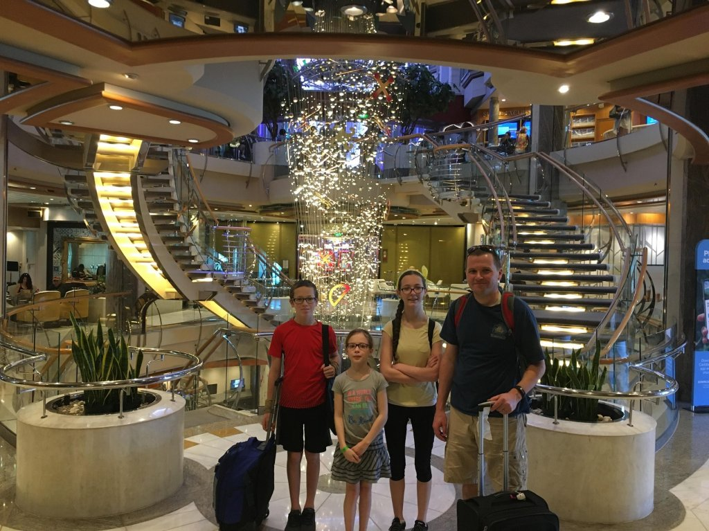 family in front of staircase