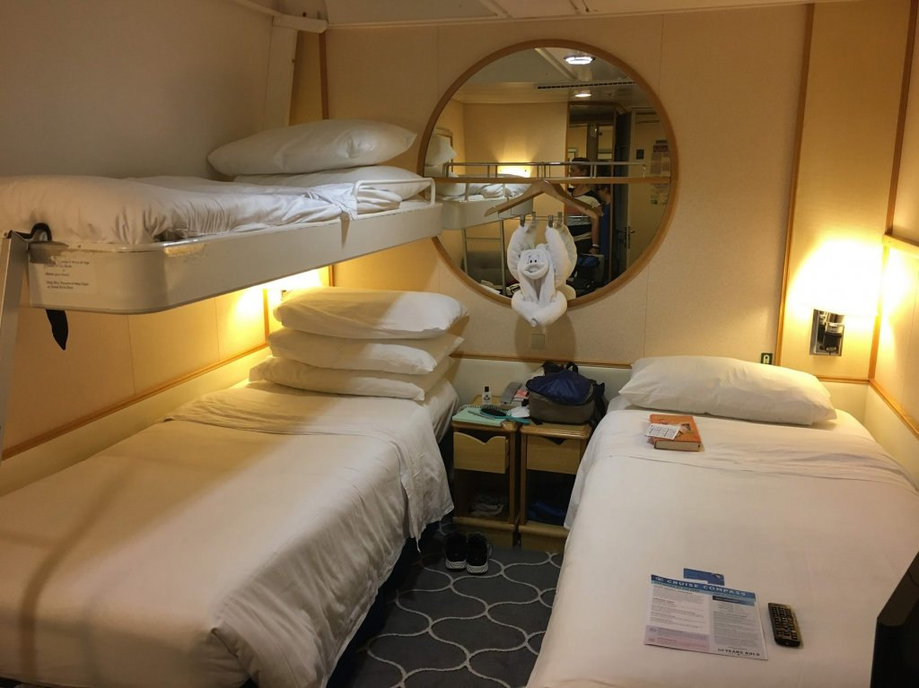 stateroom with three beds on cruise ship
