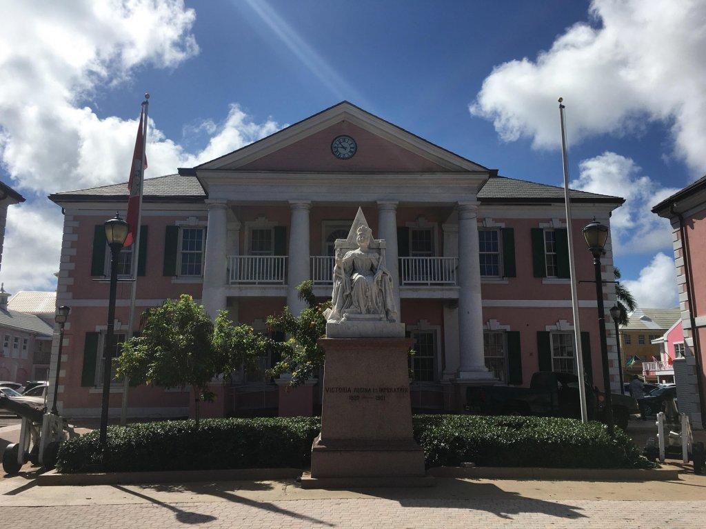 statue of queen in front of building