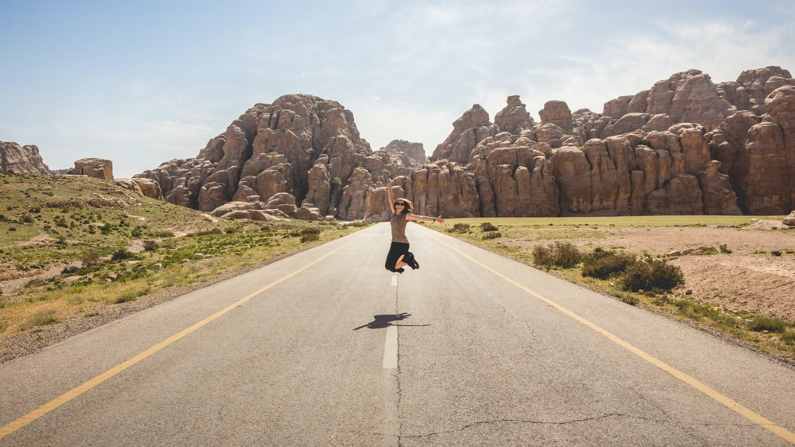 woman jumping in road