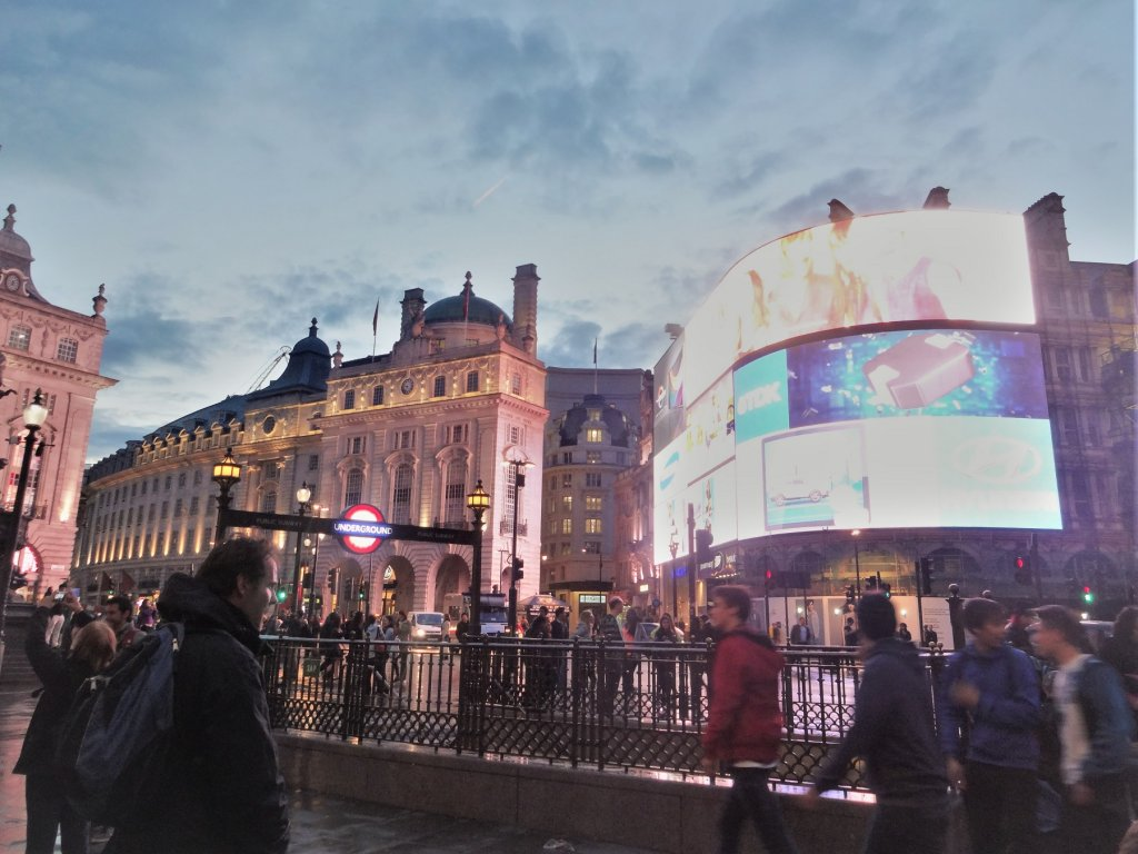 large curved television screen on building