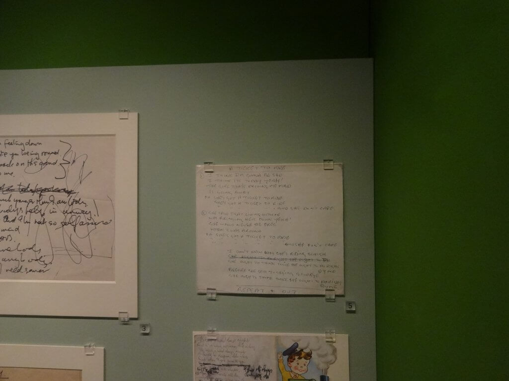 handwritten posters on a wall