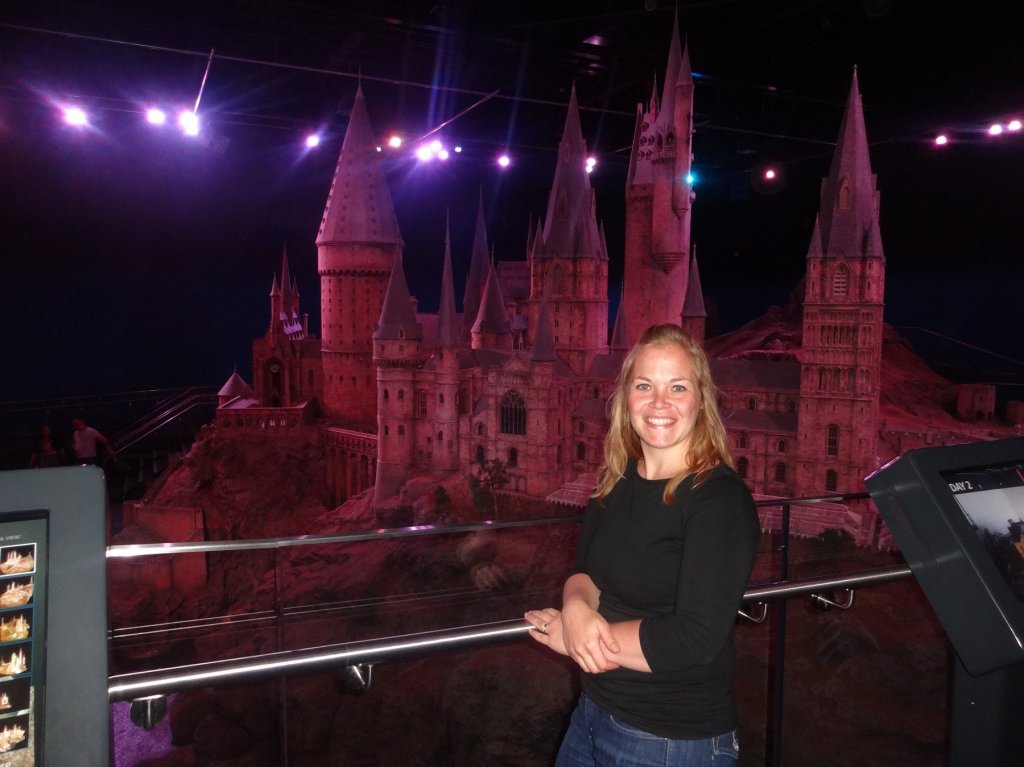 woman in front of castle model