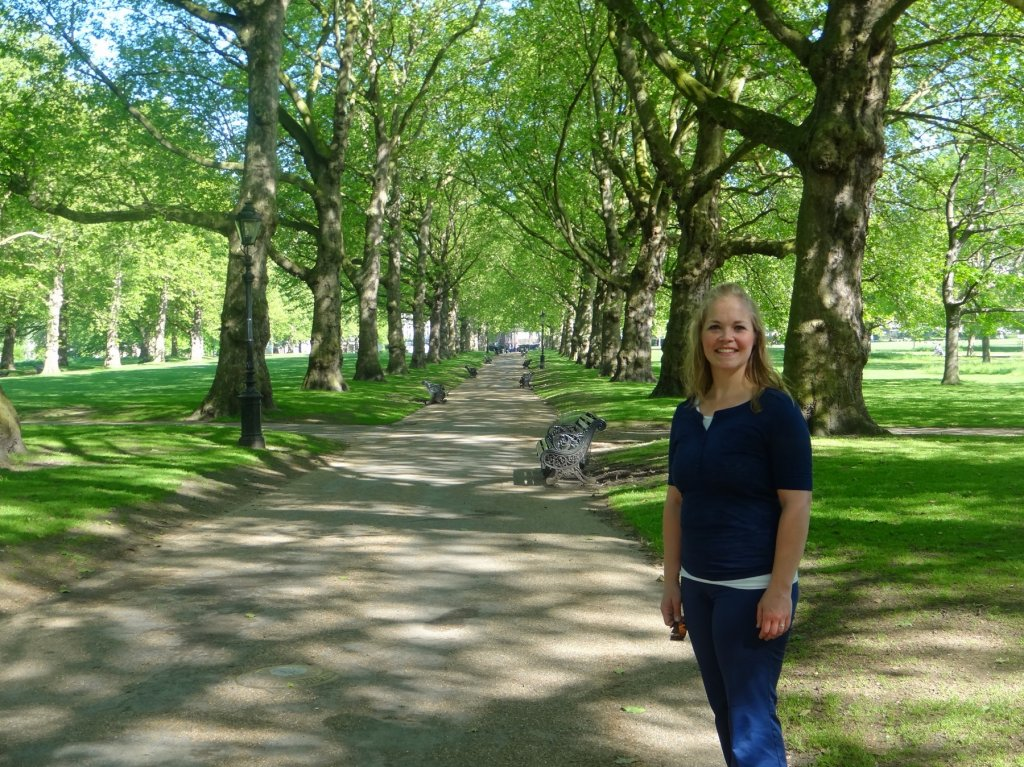 woman on tree-lined path