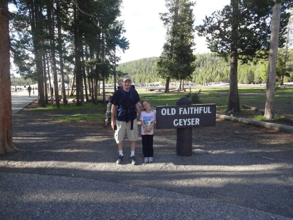 Father and daughter with sign