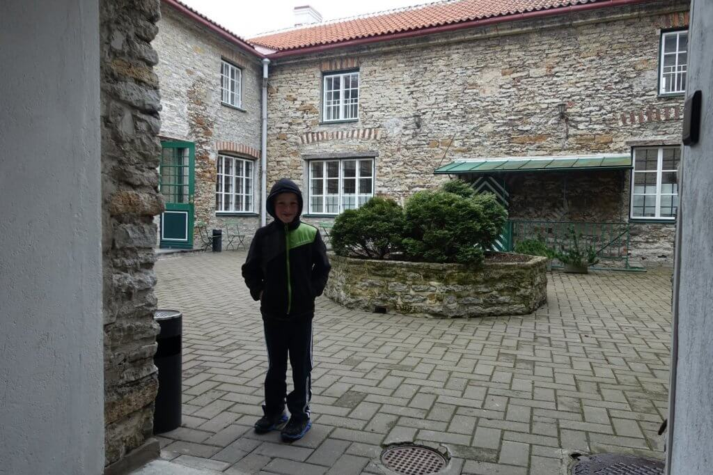 boy standing in courtyard