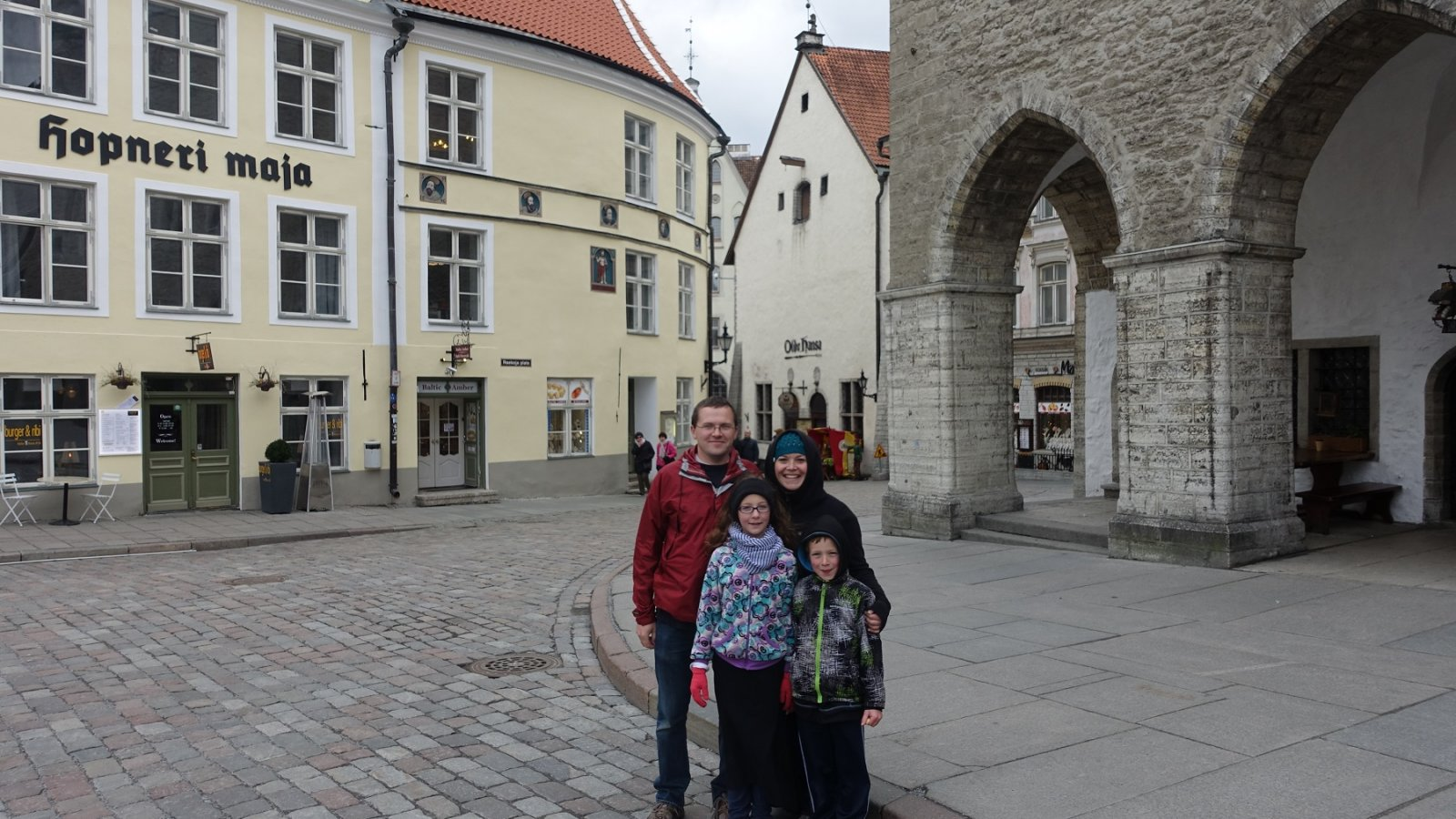 family in front of old buildings