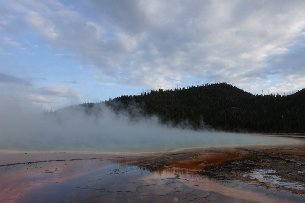 thermal water and steam in front of mountain