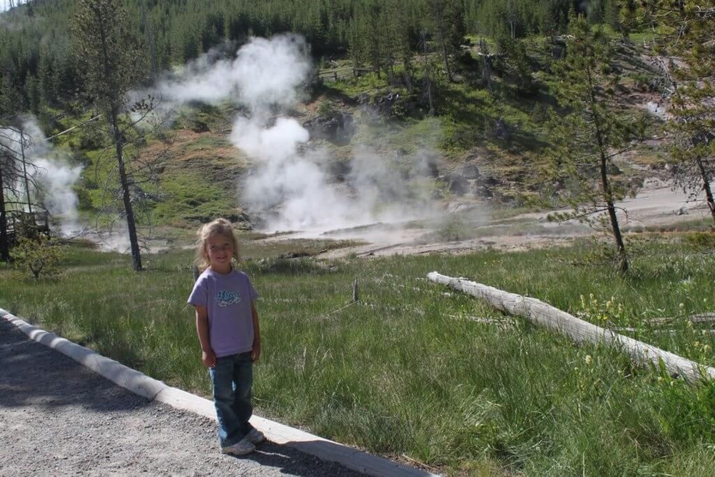 Girl in front of steam vents