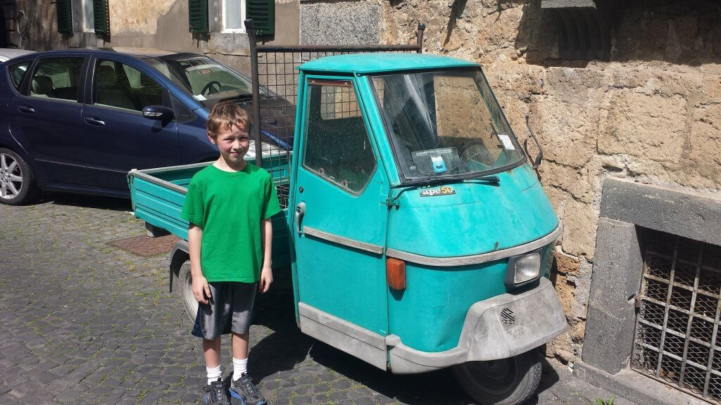boy by small truck