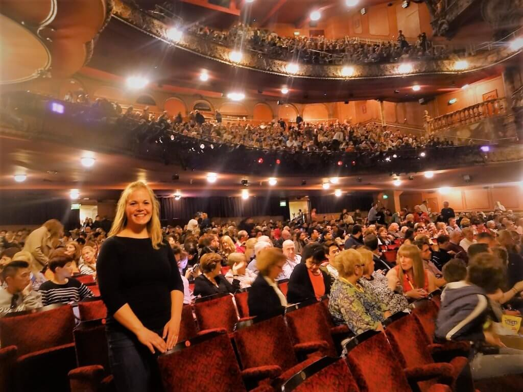 woman inside a crowded theater