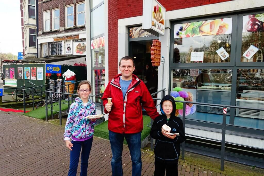 man and kids with sweets