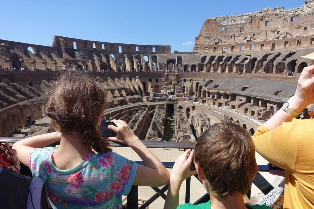 kids taking pictures inside Colosseum