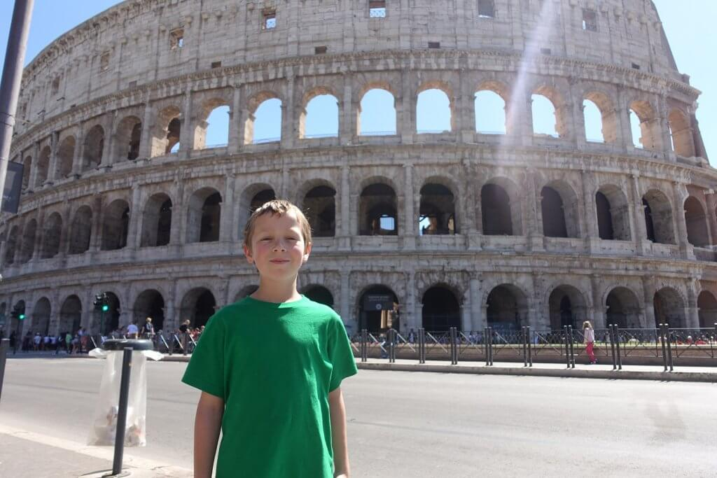 boy in front of the Colosseum