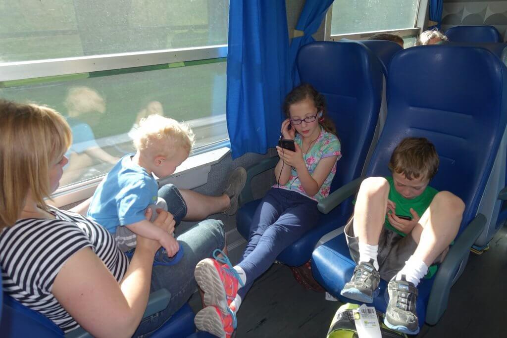 kids on phones on a train