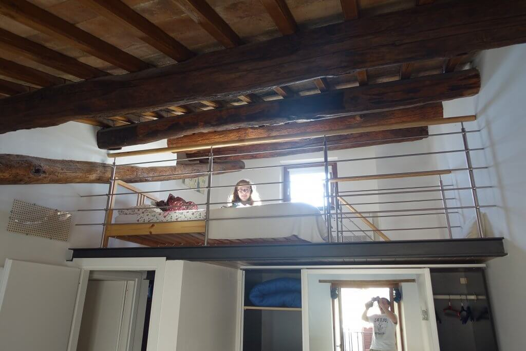 girl on a bed in loft