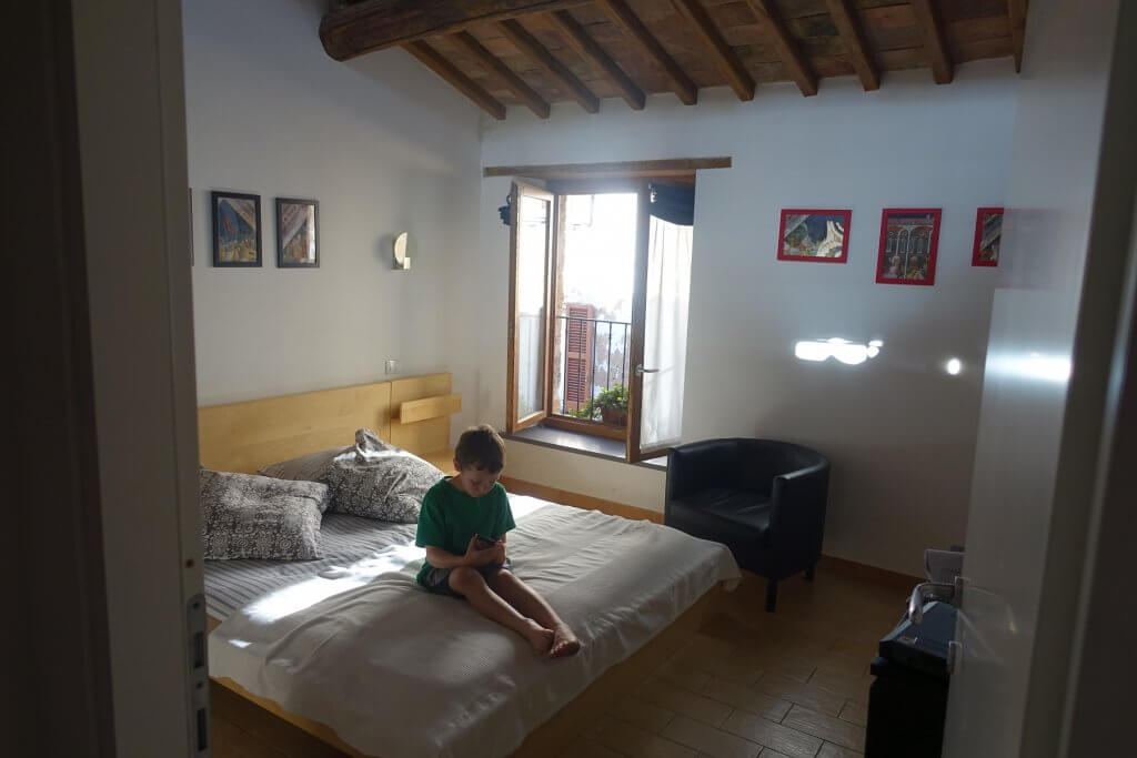 boy on a bed in apartment
