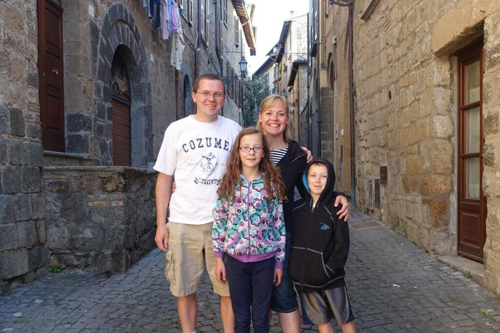 family on cobbled street