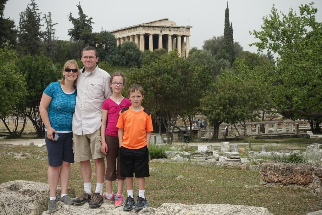 family in front of columned building