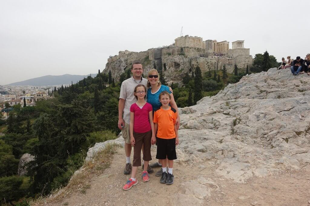family in front of ancient structures