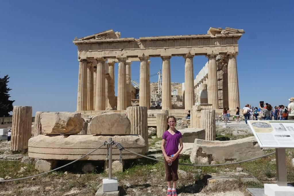 girl in front of ancient building