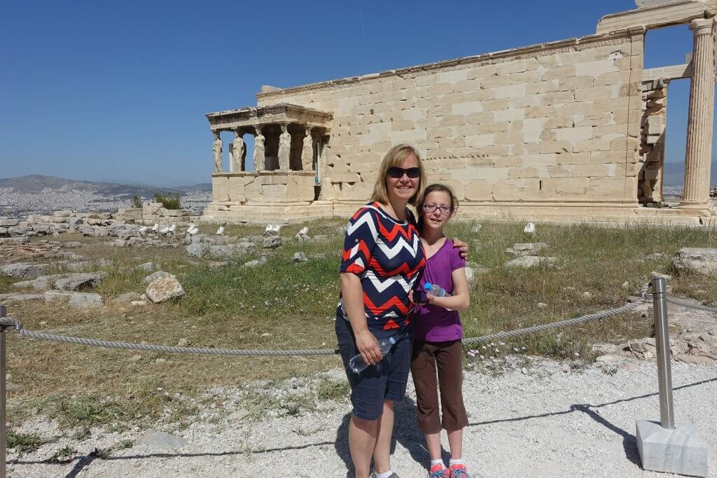 woman and girl in front of ancient building