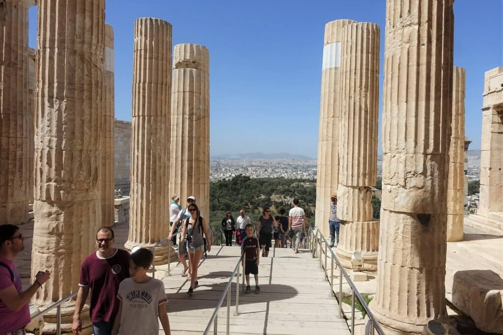 people on path between large columns