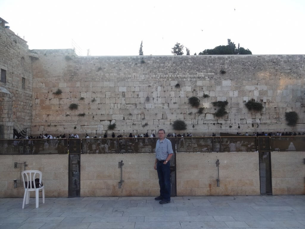man in front of a wall