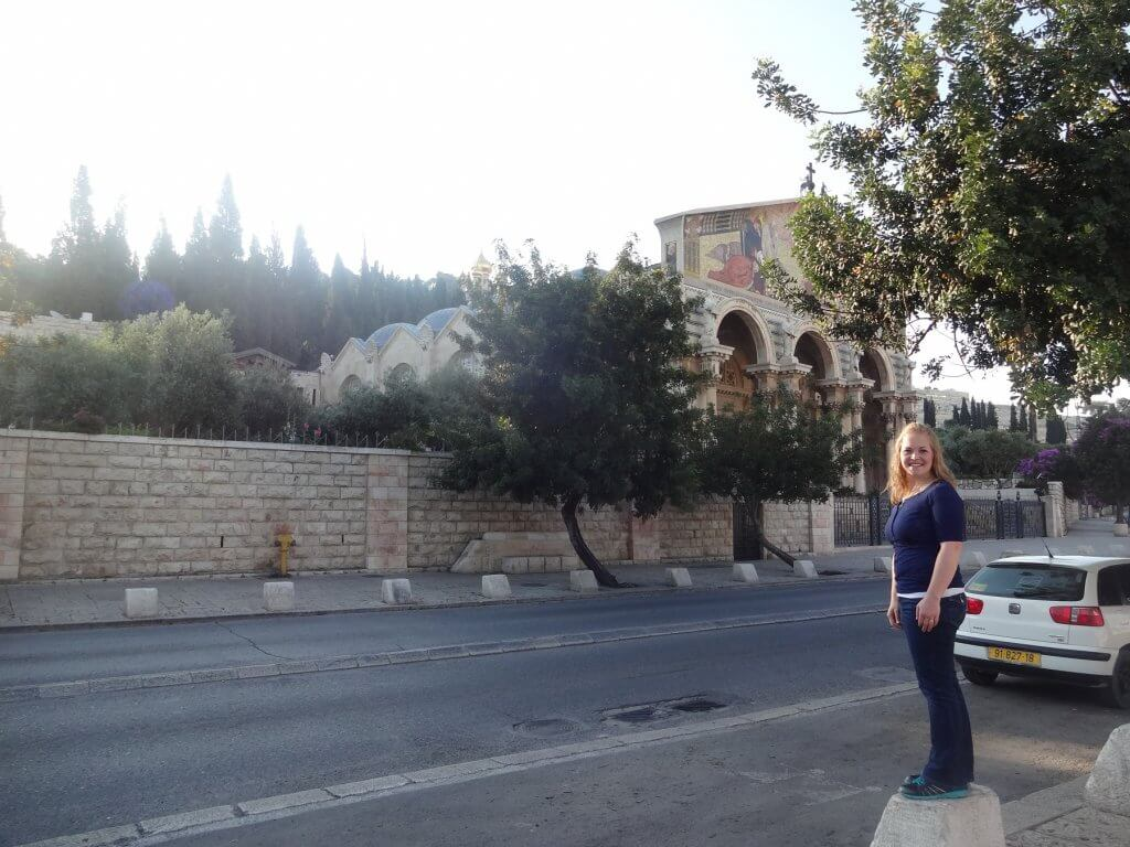 woman in front of ancient church
