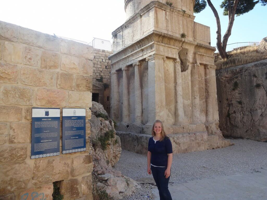 woman in front of ancient tomb