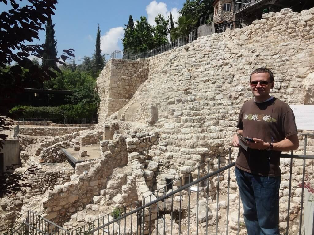 man in front of ancient stone structures