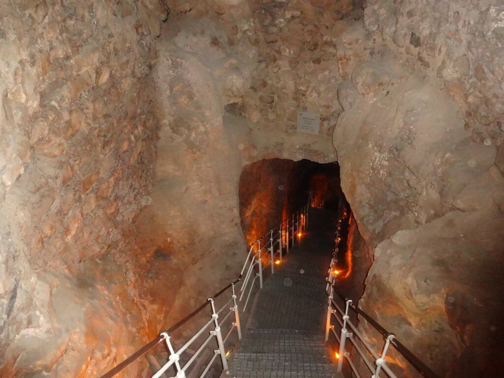 staircase into stone tunnel