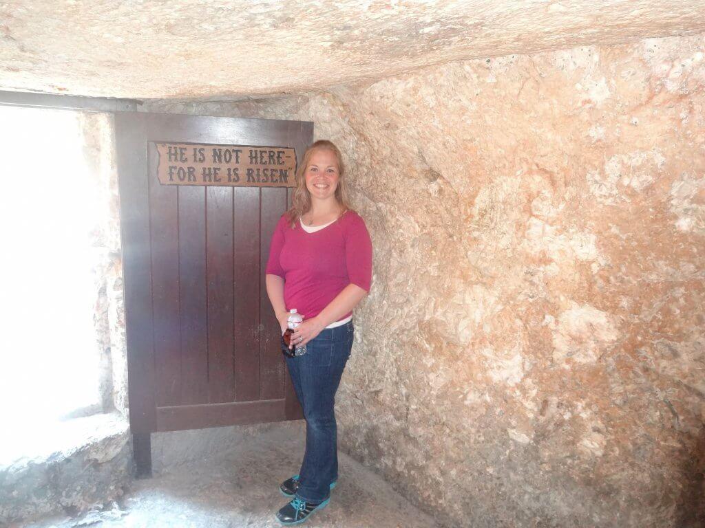 woman standing in tomb by door