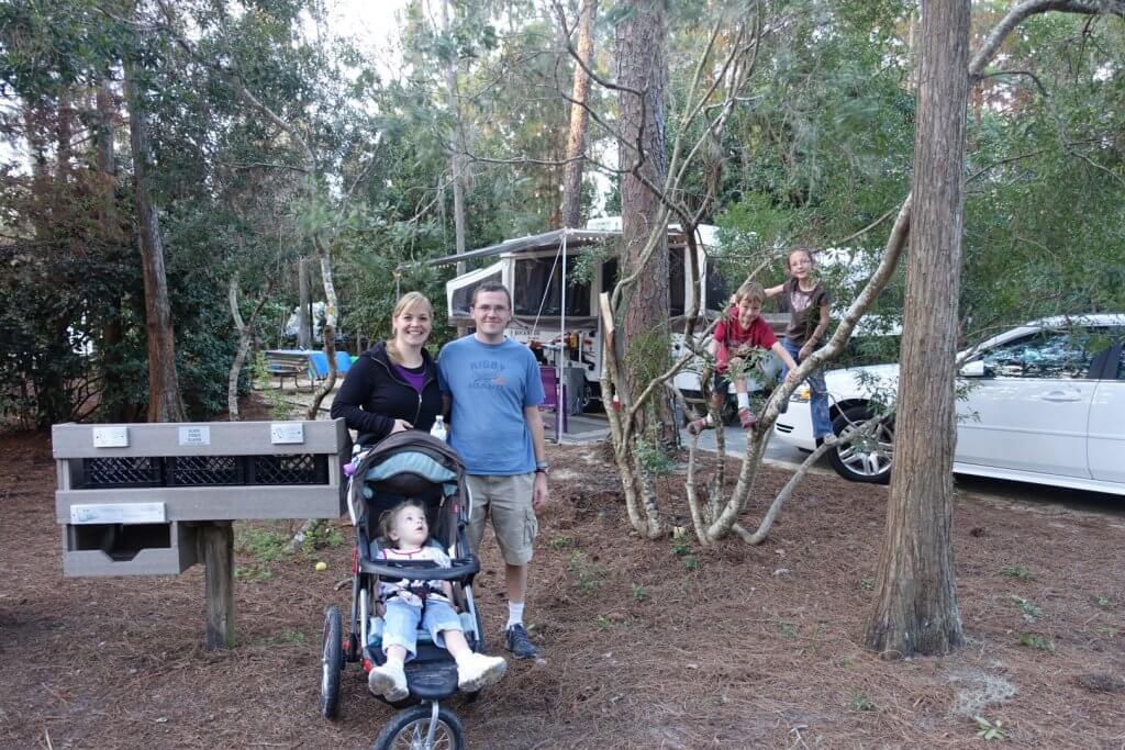 parents and children at campsite