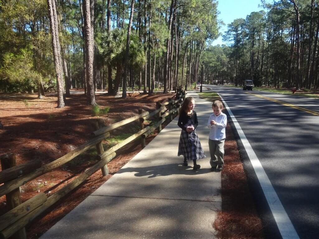 girl and boy on a sidewalk at campground