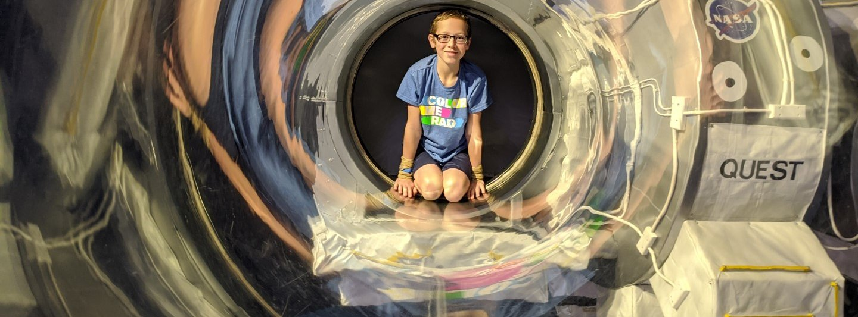 boy in a clear tube