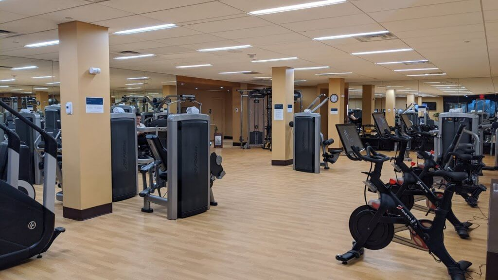 Exercise room with bikes and weight machines
