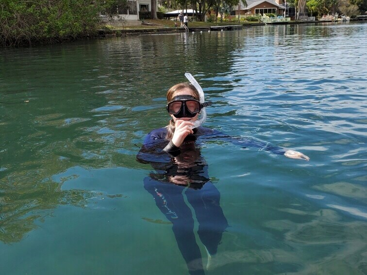 girl swimming with snorkel maks